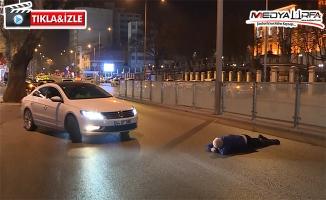 Ankara'da yol ortasına yatan kişi zor anlar yaşattı